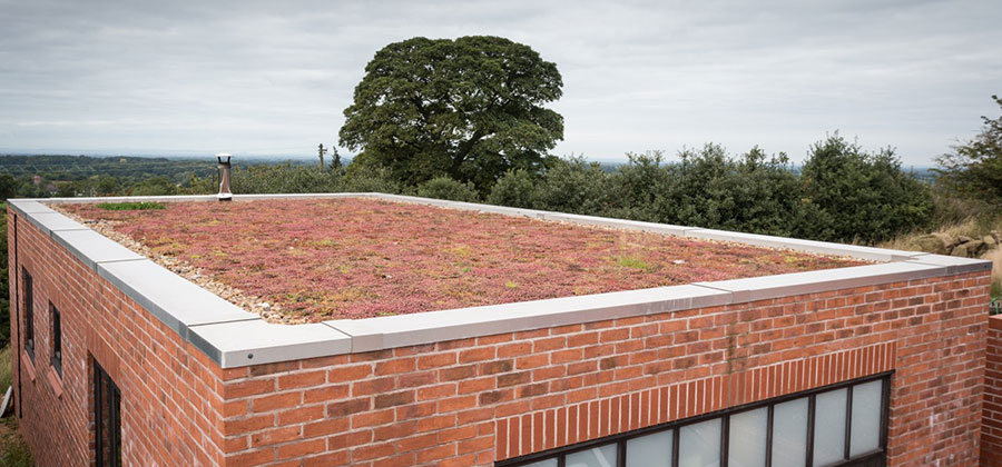 An insulated green rubber roof on a home in Staffordshire