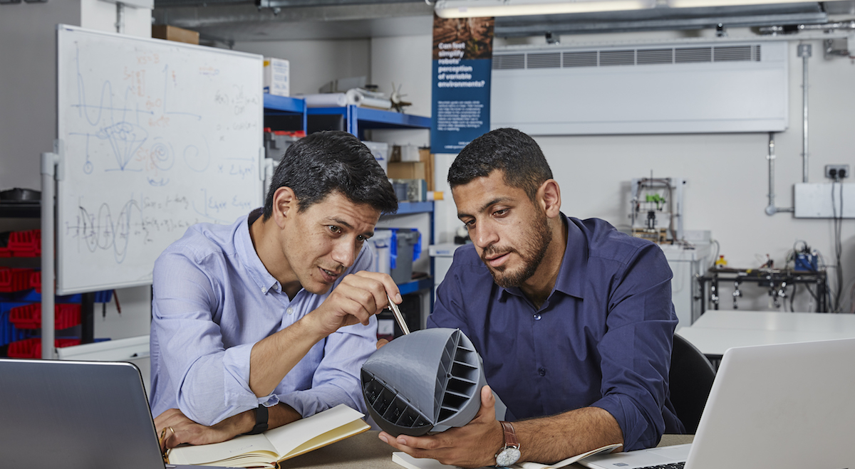 Blowing in with a new invention - Nicolas Orellana (left) and Yaseen Noorani with their novel O-Wind Turbine.