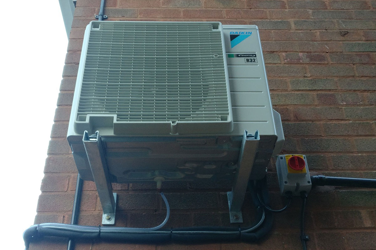 Air source heat pump installed to heat and cool conservatory all year around.