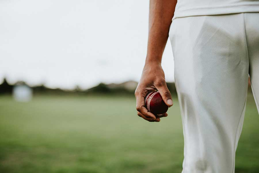 Cricketer with ball.