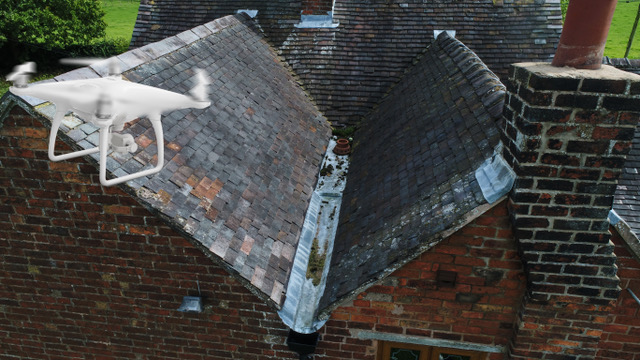Drone inspecting a roof.