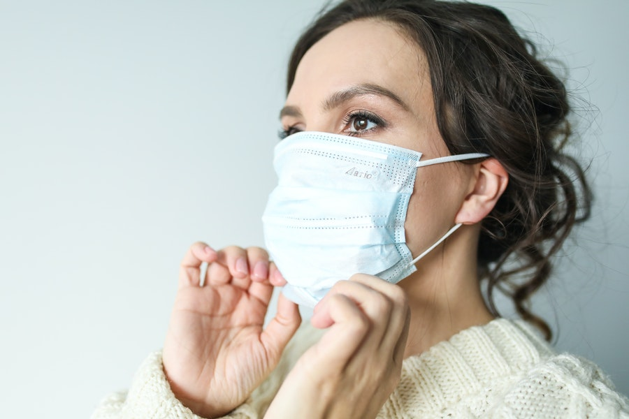 Woman in disposable facemask