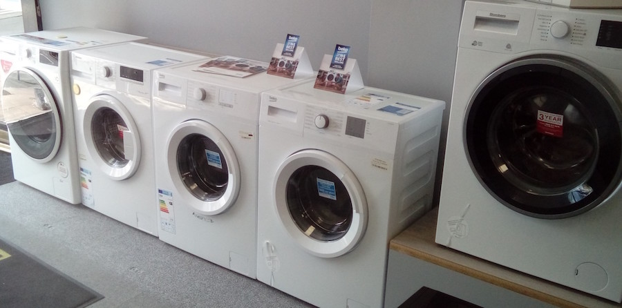 Washing machines on display in an electrical store