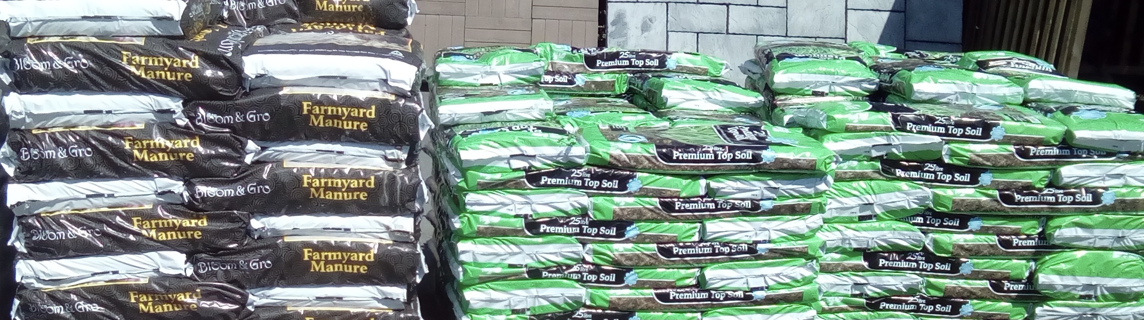 Bags of compost in piles